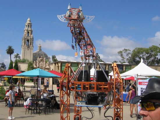Back down El Prado, and now the Electric Giraffe is on the move! This creation has been featured on national media, and even was tickled by President Obama.