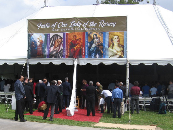 Mass was celebrated at noon in a large outside tent in nearby Amici Park.