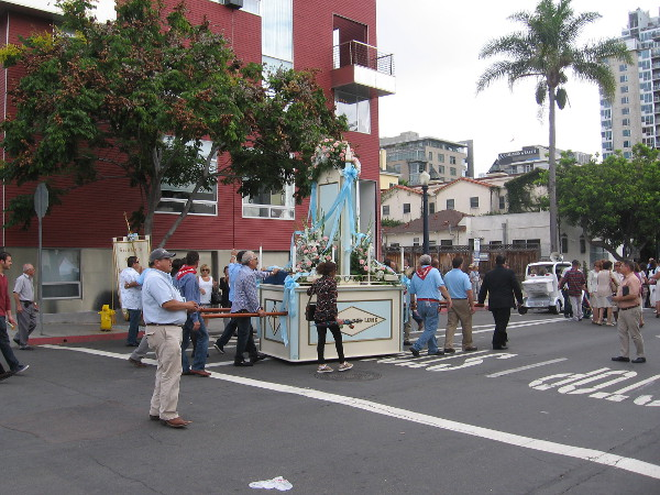 The procession slowly assembles after Mass in front of the church.