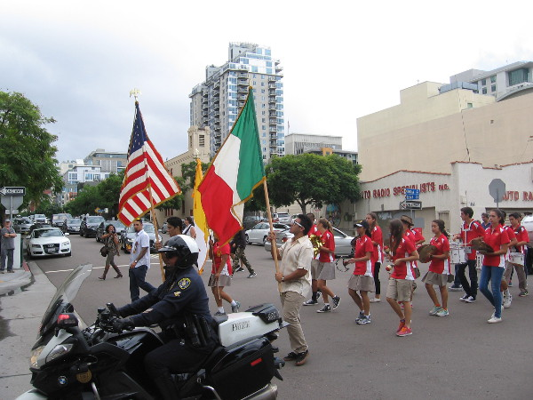 The procession is now heading north up India Street.