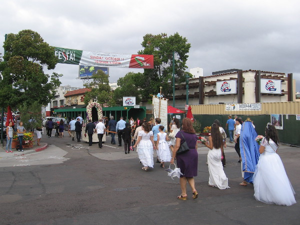 Approaching a banner announcing that next Sunday is Little Italy's popular neighborhood Festa.
