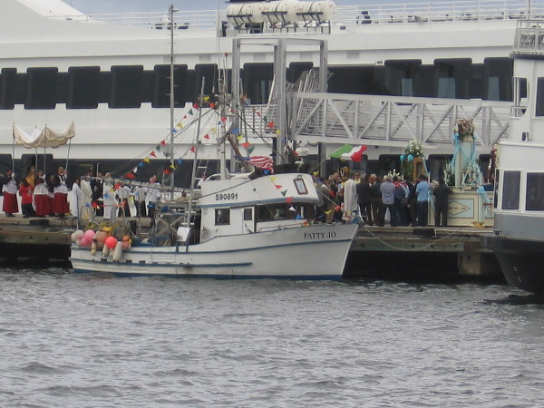 My camera could just catch a glimpse of the elaborate Catholic ritual beside the Patty Jo fishing boat.