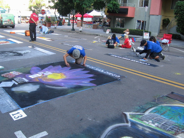 Before Festa opens, chalk artists work on their creations on two blocks of Beech Street in downtown San Diego.