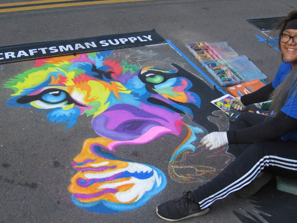 Meg. A big smile and a boldly colored work of chalk art taking form on a San Diego street during Festa!