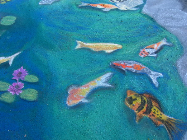 Lydia Puentes Phillips. Very color koi swimming in the Balboa Park reflecting pool. Great chalk art that captures one of my favorite places!