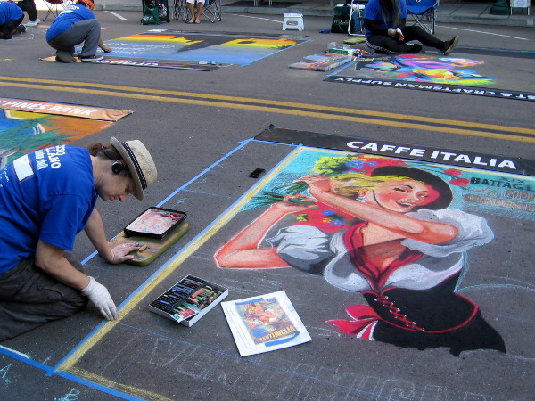 Soon thousands will crowd the street to enjoy this great chalk art. I swung by early and got photos of works in progress!