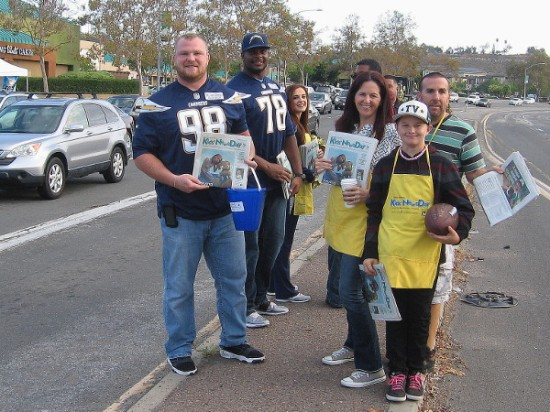 Smiling Chargers football players helping to raise money for kids included Sean Lissemore, nose tackle, and Tyreek Burwell, tackle. Everyone was having a great time!