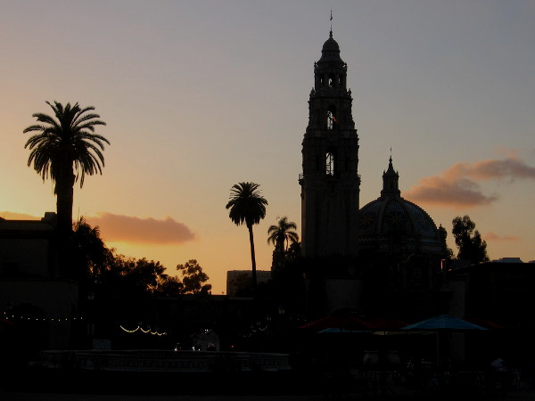 Glowing orange clouds at day's end, and the California Tower in silhouette. Photo taken from Plaza de Panama in San Diego's Balboa Park.