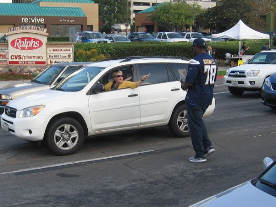 A generous motorist at a Mission Valley intersection donates money for a special edition newspaper containing articles about kids, written by kids!