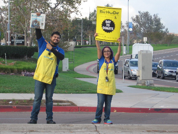 Two cool volunteers raise money for Rady Children's Hospital by selling special newspapers during Union-Tribune Kids' News Day in San Diego.