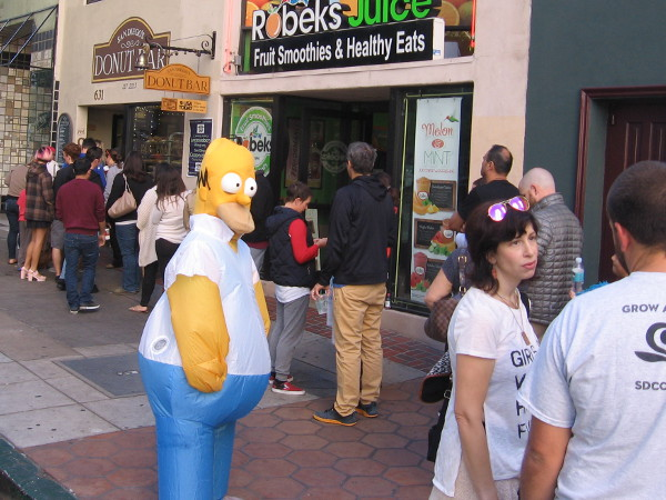 Homer Simpson was out greeting a long line of Donut Bar customers one Saturday morning!