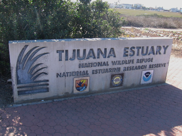 Sign near the entrance to Visitor Center of Tijuana Estuary, home of a National Wildlife Refuge and National Estuarine Research Reserve.
