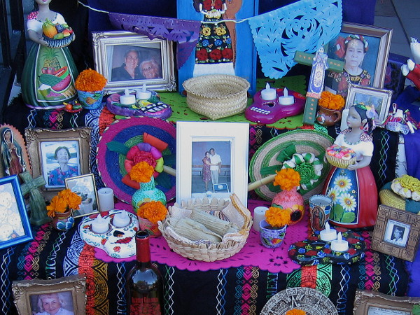 A traditional Dia de los Muertos altar in Sherman Heights summons ancestors and close loved ones who have passed from this world.
