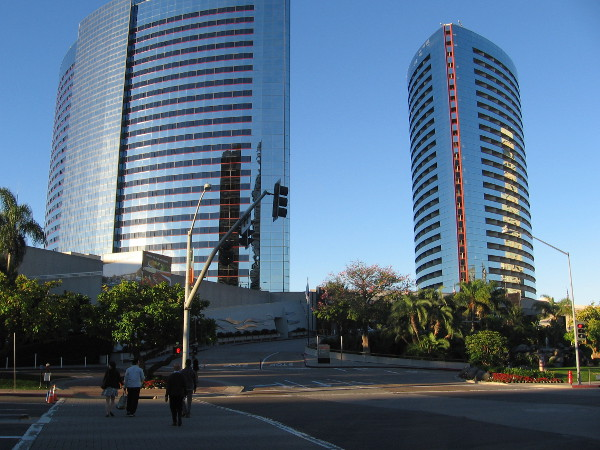 The silvery curving towers of the Marriott Marquis as seen from across Harbor Drive. The cluster of trees on the right contain a wonderful secret.