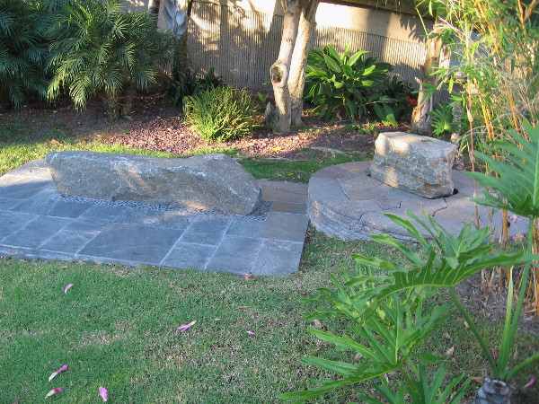 Two beautiful stone benches invite meditation.