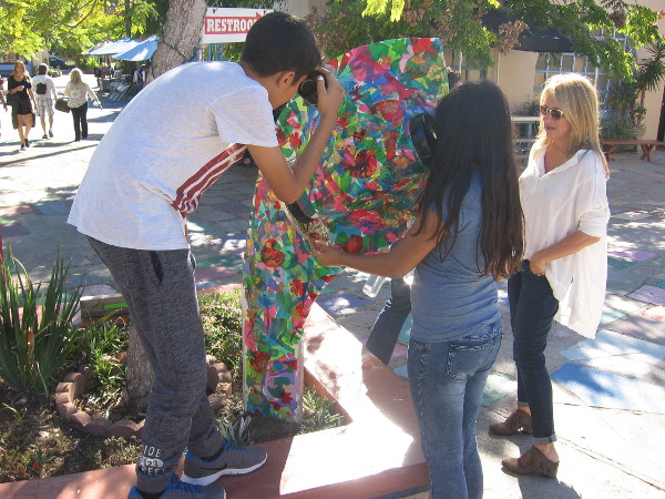 Visitors to Balboa Park look into a double kaleidoscope! This wildly colorful sculpture represents psychedelic art, which originated from 1960s counterculture.