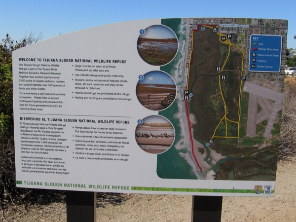 Sign welcomes visitors to Tijuana Slough National Wildlife Refuge. Five endangered and two threatened species of birds are protected here in their natural habitat.