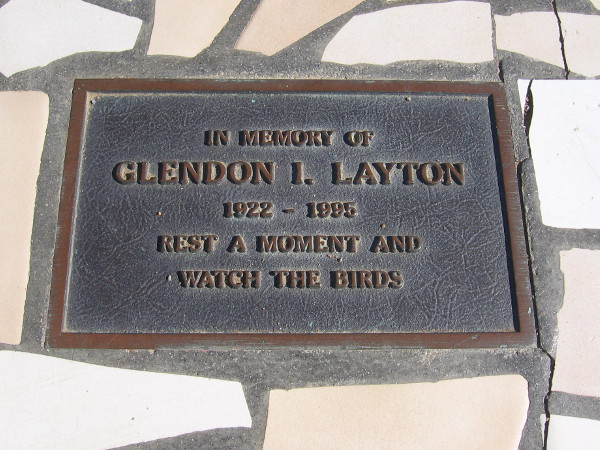 Plaque on another bench at the south end of the trail. In memory of Glendon I. Layton. Rest a moment and watch the birds.