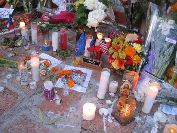 Candles remain lit the morning after the vigil. Signs, messages, flowers and letters show support for France and love for those who died during the Paris terror attack.