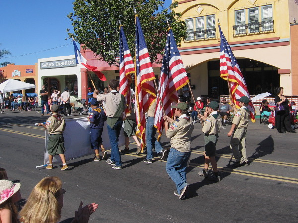 The Boy Scouts parade the colors down Main Street in El Cajon.
