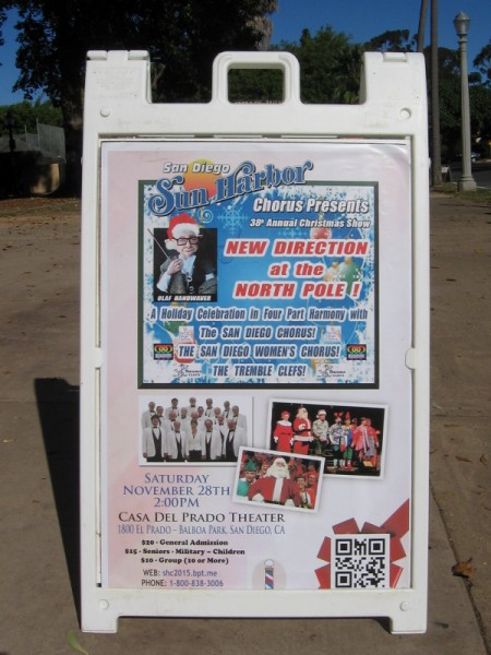 Poster in Balboa Park advertises New Direction at the North Pole! Joyful music will fill San Diego during the holiday season.