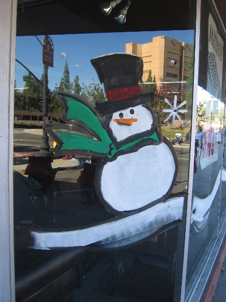 Frosty the Snowman painted on a store window in San Diego's sunny East County.
