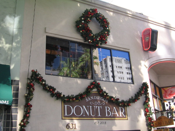 Traditional holiday garland and colorful ornaments festoon the famous Donut Bar in downtown San Diego.