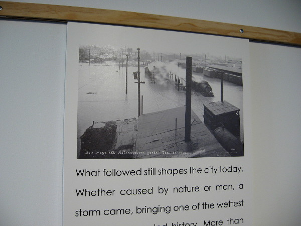 Photo at RAINMAKER exhibition shows catastrophic San Diego flooding caused by 30 inches of rain in 1915.