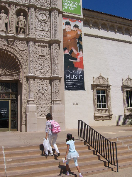 People head up steps from Balboa Park's Plaza de Panama to visit the wonderful San Diego Museum of Art.