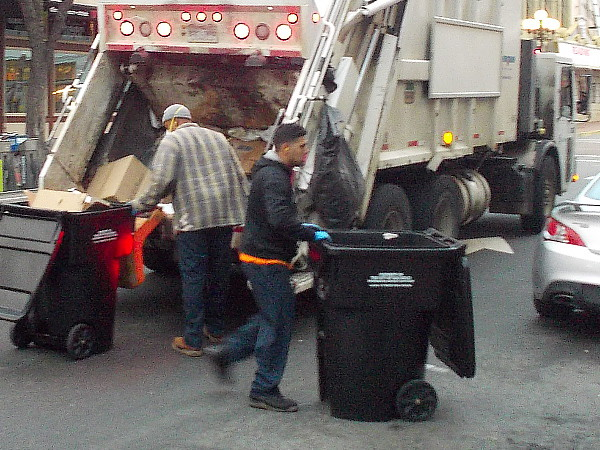 Early Wednesday morning in downtown San Diego, and men are hard at work collecting the city's trash.
