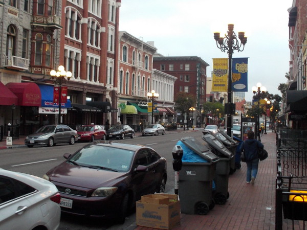 Rows of garbage receptacles in the Gaslamp. The remnants of good times.