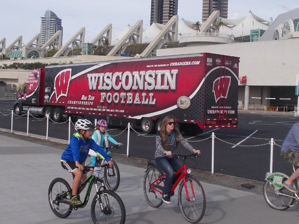 Wisconsin Football semi-trailer truck parked conspicuously behind the San Diego Convention Center. The years of their 14 Big Ten Championships are proudly displayed.