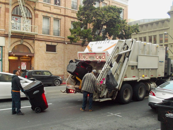 Collecting garbage in downtown San Diego while many still sleep.