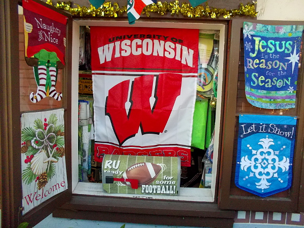 Alamo Flags in Seaport Village has a big University of Wisconsin banner in one window.