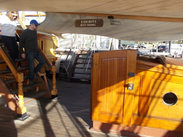 Visitors descend from the poop deck. Beautiful woodwork is found all about the ship. But the elements can be harsh.