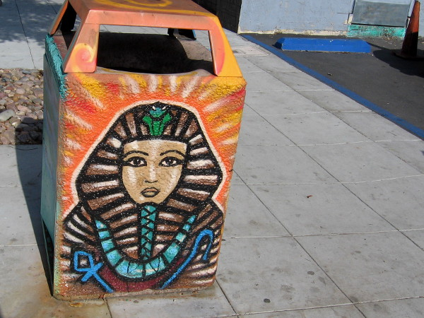 One of several trashcans on Park Boulevard and University Avenue painted with colorful Egyptian motifs.