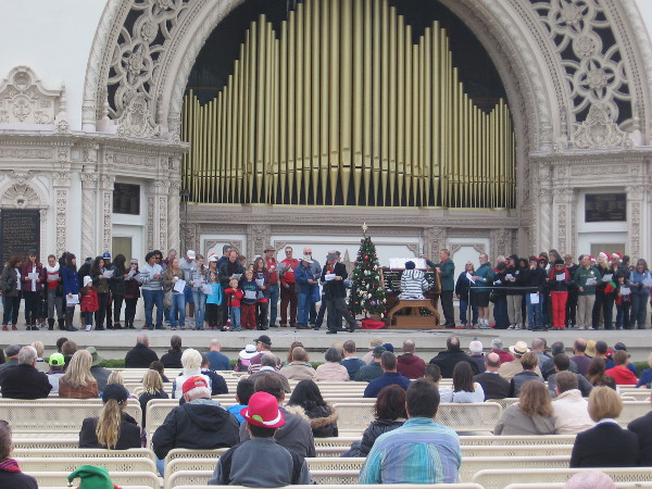 Ordinary people from San Diego and around the world gather in Balboa Park to sing Christmas carols at the Spreckels Organ Pavilion.