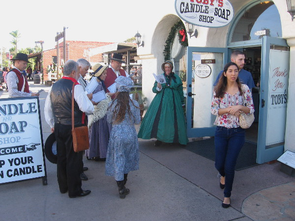 Joyful, uplifting Christmas carols are sung as customers leave Toby's Candle and Soap Shop.