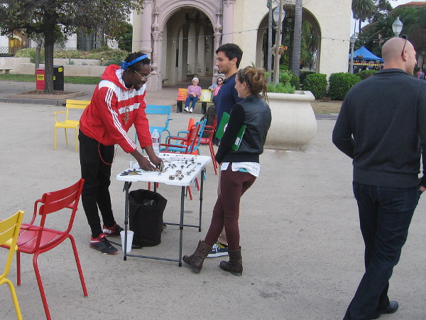 Guy shows some people his stuff in the Plaza de Panama.