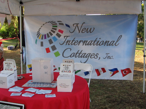 New International Cottages display explains expansion plans in Balboa Park. Photo taken during December Nights.