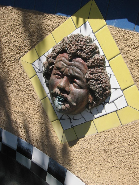 An artistic face in a fountain by the Old Globe Theatre.