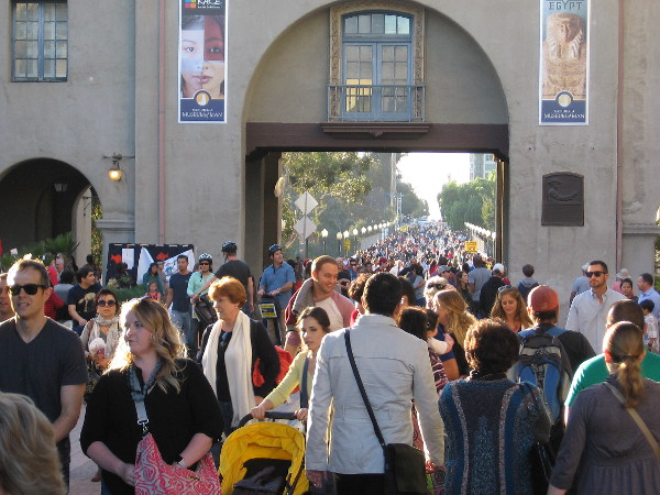 Tens of thousands stream into Balboa Park from across the Cabrillo Bridge. December Nights is one of the largest holiday festivals in the United States.