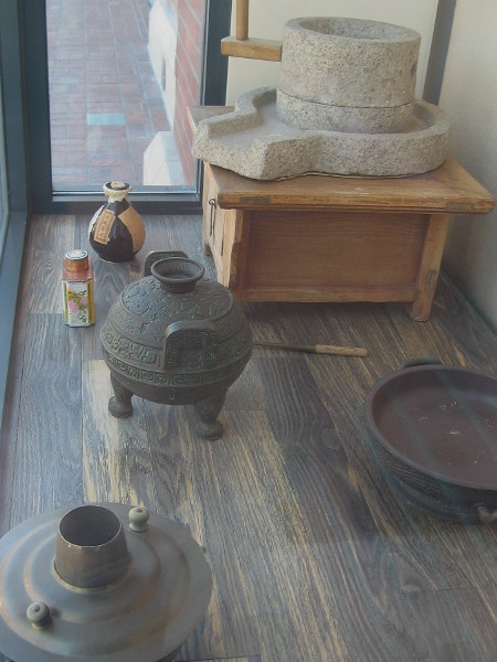 Display includes various articles used for food preparation and cooking in San Diego's old Chinatown.