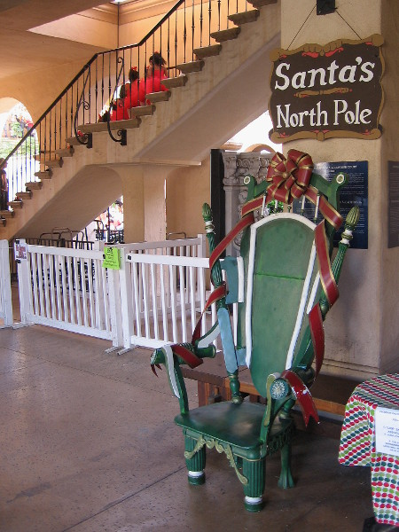 One of the Santas in Balboa Park will be stationed here in the Casa del Prado once night falls.