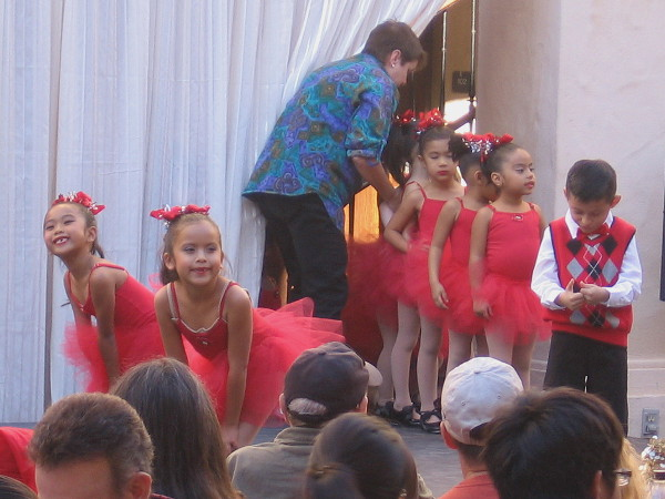 Children file onto a stage on the Casa del Prado patio. Joyful dancing could be seen here throughout the day.