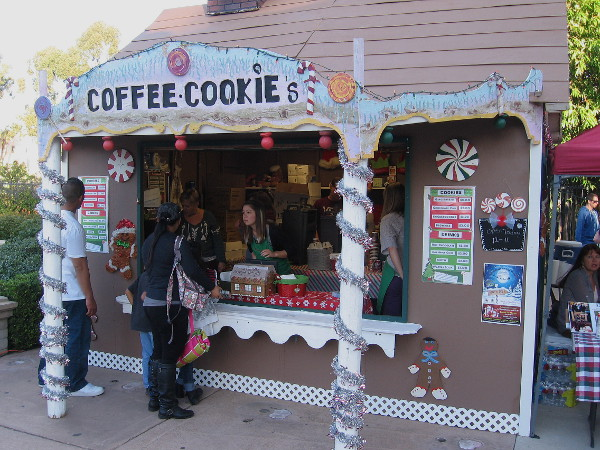 Folks are buying goodies at the cookie shack near the Spreckels Organ Pavilion during December Nights.