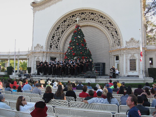 In mid-afternoon, the Peninsula Singers community choir was performing on stage beneath the giant Christmas tree.