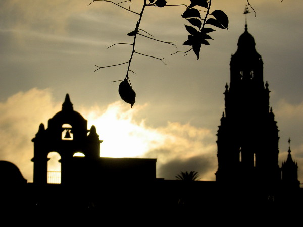 The House of Charm and California Tower in silhouette as day ends.