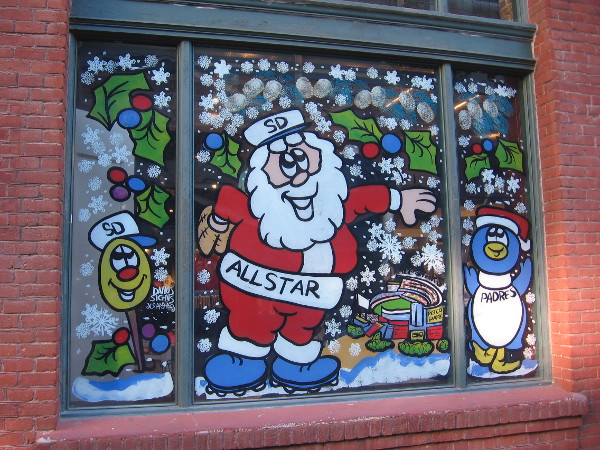 Just before Christmas, All-Star Santa has been painted on the window of the San Diego Padres Store in the Western Metal Supply Co. Building!