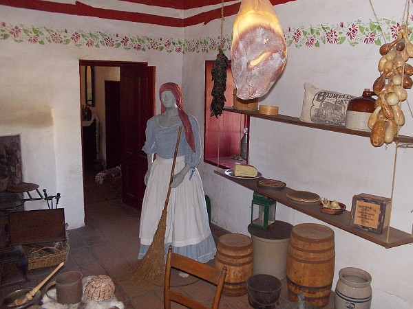 A variety of dried food hangs from the ceiling. The kitchen of the Commercial Restaurant museum in Old Town is a place where visitors are transported back in time.